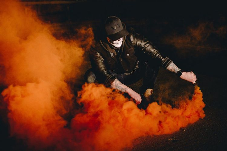 Flame One Person Danger Burning Smoke - Physical Structure Real People Heat - Temperature Men Night Adults Only Protective Workwear Protective Mask - Workwear Adult One Man Only People Outdoors Firefighter Inferno Smokebomb