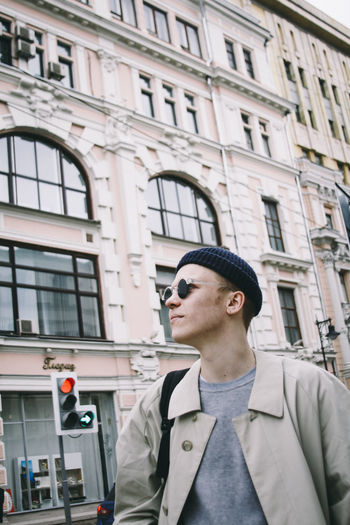Architecture Building Built Structure Casual Clothing Center Of Moscow Centre Of Moscow City City Center City Centre City Life Day Guy Hat Headshot Leisure Activity Lifestyles Outdoors Portrait Sunglasses Walking Around The City