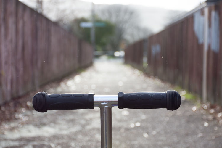 Close-up of bicycle parked on railing