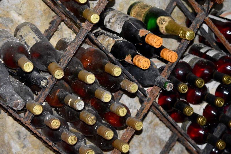 Old wine bottles in rack