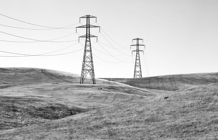 Electricity  Electricity Pylon Power Supply Power Line  Connection Electricity Tower Low Angle View Landscape Fuel And Power Generation Technology Cable Hill Clear Sky Non-urban Scene Countryside Country Hilltop Hilltops IntheCountry Powerlines Black And White Blackandwhite Black & White Outdoors Monochrome