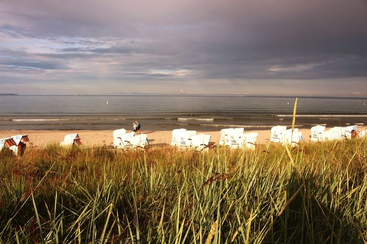 Scharbeutz Ostsee Ostseeküste Strandkorb Strandkörbe Strand Beach Beachphotography Natur Nature EyeEm Best Shots - Nature EyeEm Best Shots EyeEmBestPics Sky And Clouds Sky Dünen Dünengras Dünenlandschaft East Sea Sonnenuntergang Sunset Dunkle Wolken Regenwolken Schlechtes Wetter Nach Regen
