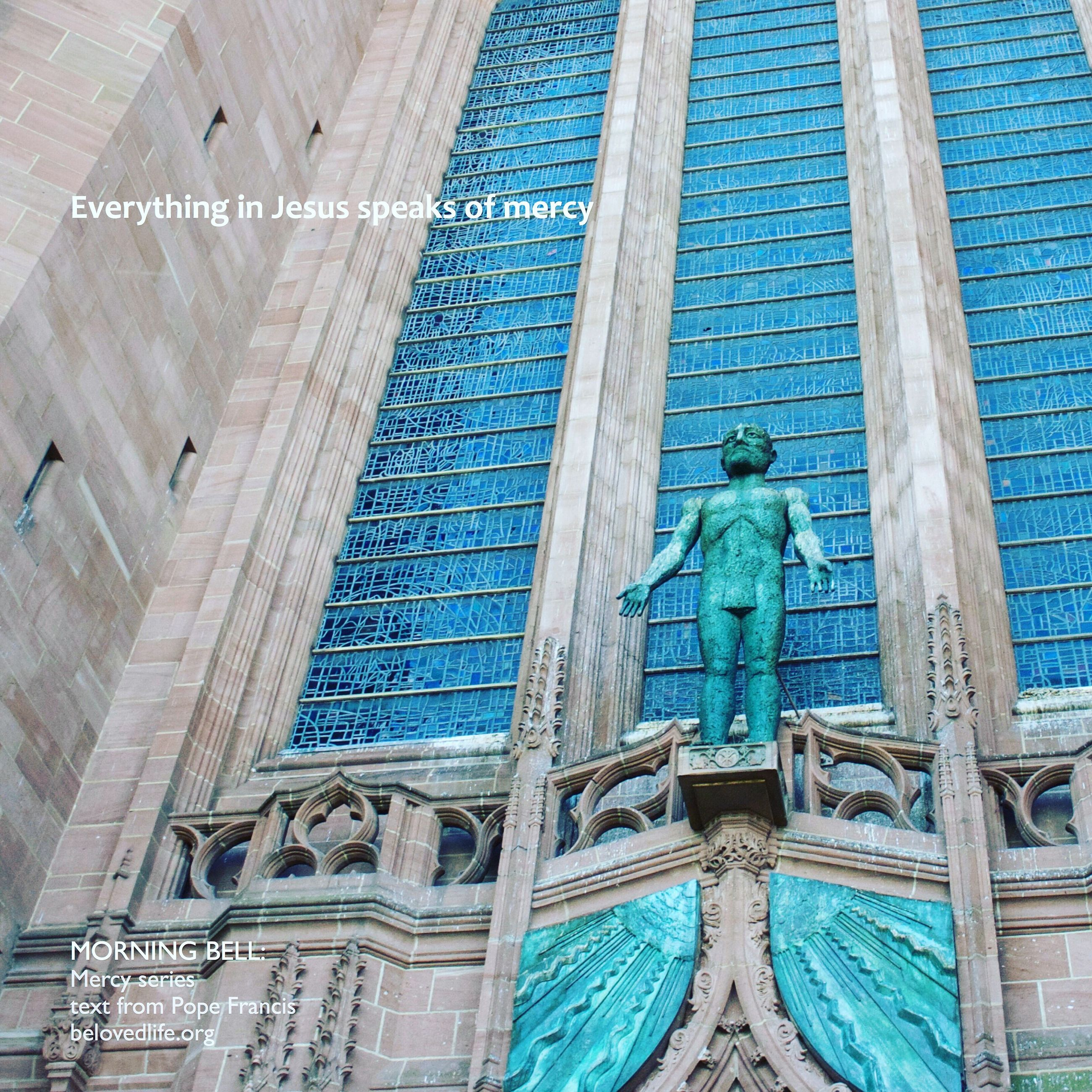 architecture, art and craft, built structure, art, building exterior, creativity, human representation, low angle view, blue, sculpture, building, statue, wall - building feature, outdoors, day, carving - craft product, pattern, city, graffiti