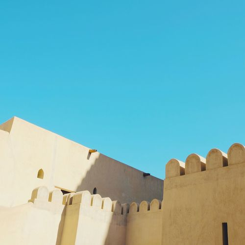 Architecture Built Structure Copy Space Clear Sky Building Exterior Blue Outdoors No People Minimalism Minimal Travel EyeEm Gallery From My Point Of View Street Photography City Outdoor Oman Nizwa Nizwa Fort Bright_and_bold Style Pantone Colors Structure The Architect - 2017 EyeEm Awards