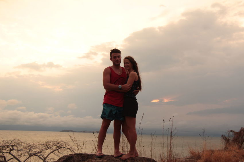 Our trip to Lake Malawi ❤ Beachwear Lake Malawi Wavy Stormy Cloudy Sky Two People Togetherness Adult Love Beach Young Adult Heterosexual Couple Sand Bonding Happiness Young Women Summer Nature Sunset Vacations Couple - Relationship Men Women People