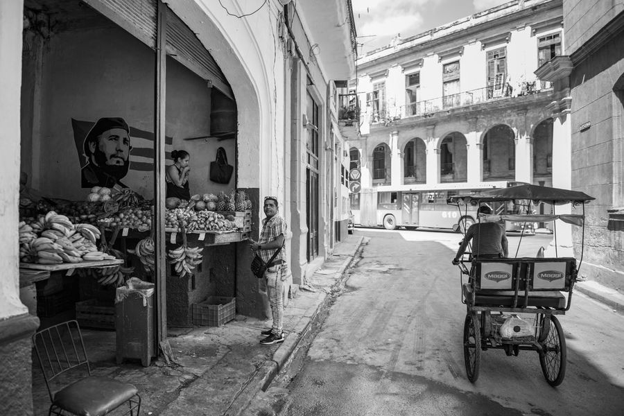 Fidel keeps a watch on this roadside market. Architecture Building Exterior Cuba Editorial  Fruit Havana Indoors  Market People Store Street The Street Photographer - 2017 EyeEm Awards Transportation Food Stories
