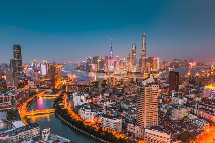 High angle view of illuminated cityscape at dusk