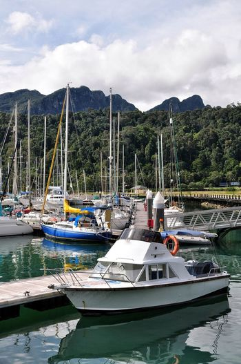 Nautical Vessel Water Transportation Lake Moored Travel Destinations Outdoors Cloud - Sky Day Tranquility Nature No People Scenics Pedal Boat Mountain Tree Beauty In Nature Langkawi Island Malaysi