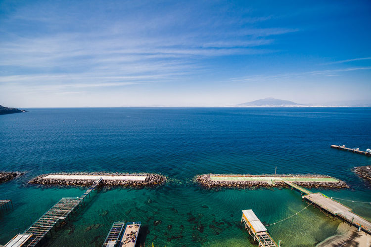 View of the Vesuvio volcano, in the bay of Naples, seen from Sorrento Bay Of Naples, Italy. Beauty In Nature Blue Day Flying High Horizon Over Water Nature No People Outdoors Scenics Sea Sky Sorrento Tranquil Scene Tranquility Vesuvio Volcano Water