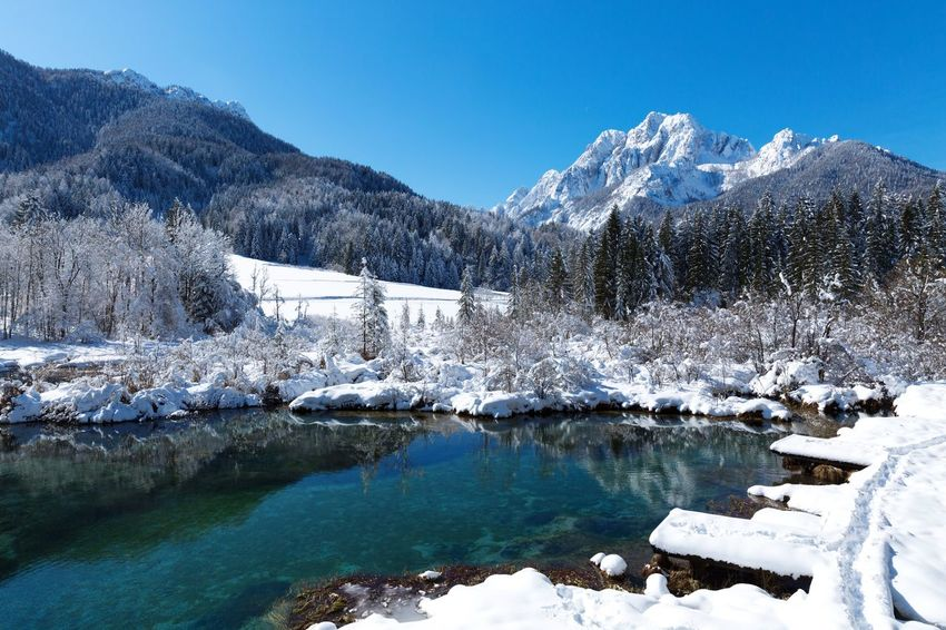 Winter landscapes Discover  Travel Winter Snow Cold Temperature Mountain Nature Beauty In Nature Tranquil Scene Scenics Tranquility No People Blue Clear Sky Tree Mountain Range Day Outdoors Ice Lake Water Frozen Shades Of Winter