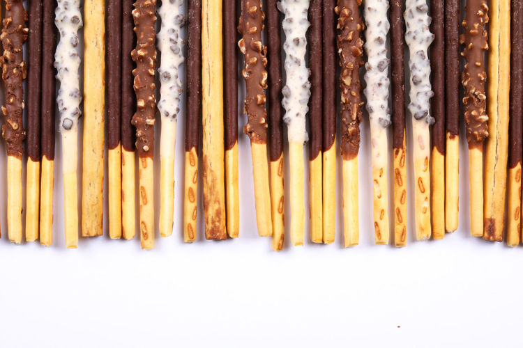Assorted chocolate dipped biscuit sticks isolated on white Biscuit Celebration Chocolate Confectionery Day Dipped  Event Food Isolated Japanese  Korean Pepero Pepero Day Pocky Popular Snack Stick White