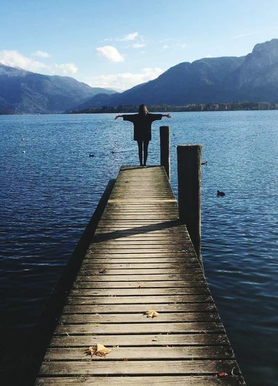 Beauty In Nature Water Outdoors Sky Nature Lake Mountain Mountain Range Free Freedom Mondsee Mondsee, Austria One Person Pier Clear Sky Landscape Scenics People Rear View Tranquil Scene Human Back Tranquility One Man Only Adult