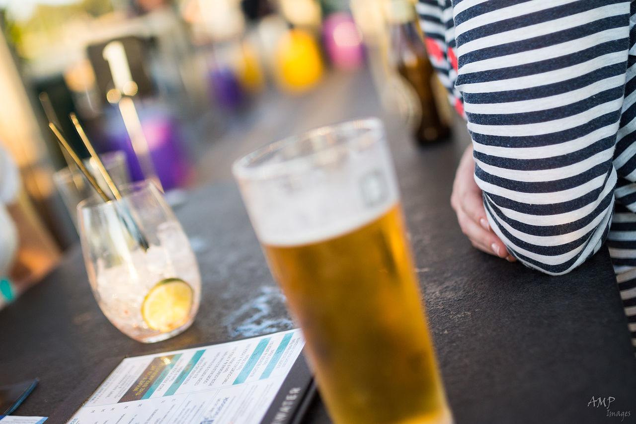 beer - alcohol, beer glass, alcohol, drink, food and drink, refreshment, table, striped, drinking glass, freshness, close-up, frothy drink, indoors, real people, one person, day, people