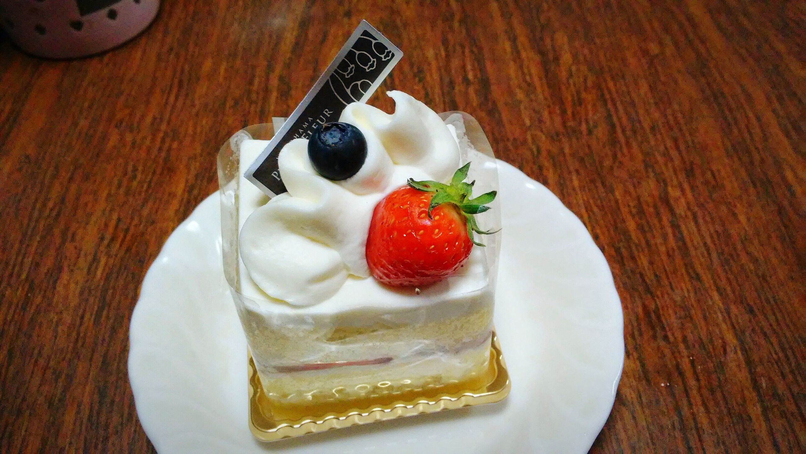 food and drink, food, indoors, freshness, still life, sweet food, ready-to-eat, table, indulgence, plate, dessert, high angle view, unhealthy eating, temptation, slice, cake, directly above, serving size, close-up