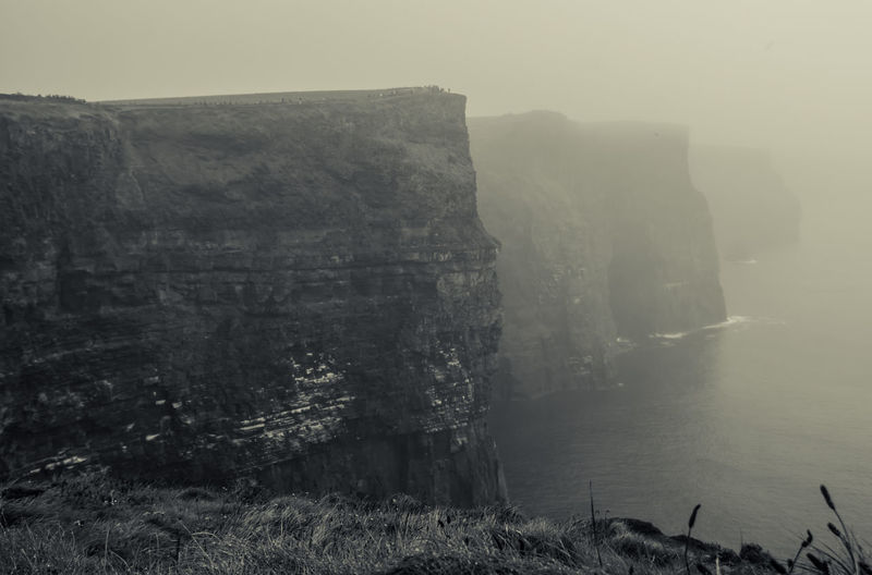 FOGGY CLIFFS OF MOHER Hello World Monochrome Landscape_photography Landscape_Collection Landscape Betterlandscapes Travel Travel Destinations Ireland Cliffs Of Moher  Foggy Morning Foggy Atlantic Ocean Sea Eroded Formation Outdoors Mountain Sky Day Land Beauty In Nature Cliff Solid Scenics - Nature Tranquil Scene No People Tranquility Rock - Object Water Rock Formation Fog Nature Rock