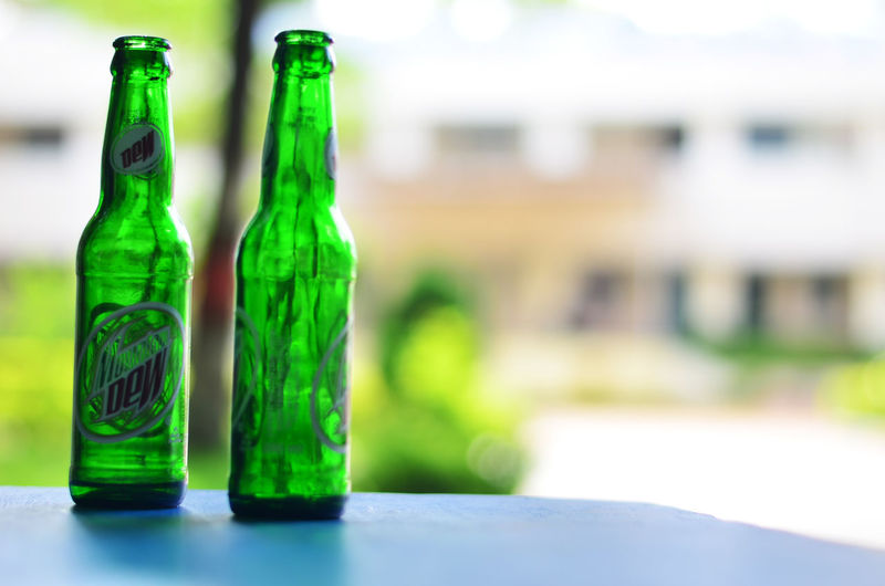Beer Bottle Bottle Car Close-up Day Focus On Foreground Food And Drink Glass - Material Green Color Horizontal No People Outdoors Winetasting
