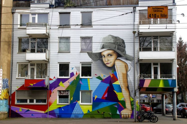 Full frame shot of multi colored graffiti on residential building