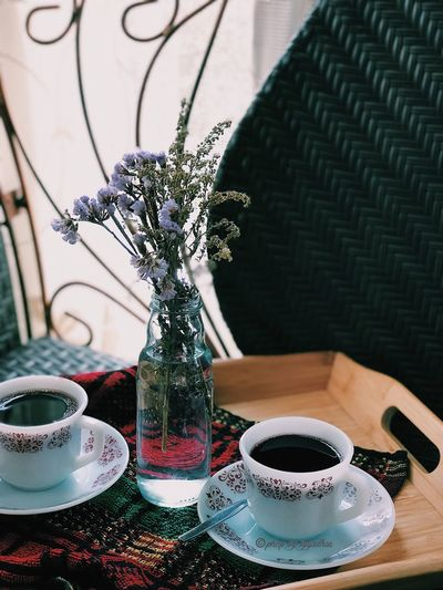 High angle view of black coffee cups on table