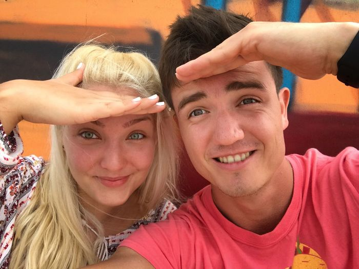 Portrait Of Smiling Couple Shielding Eyes