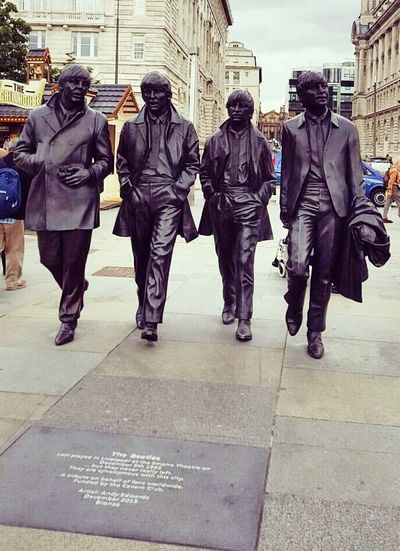 Liverpool, England John Lennon George Harrison Ringo Starr Paul Mccartney The Beatles