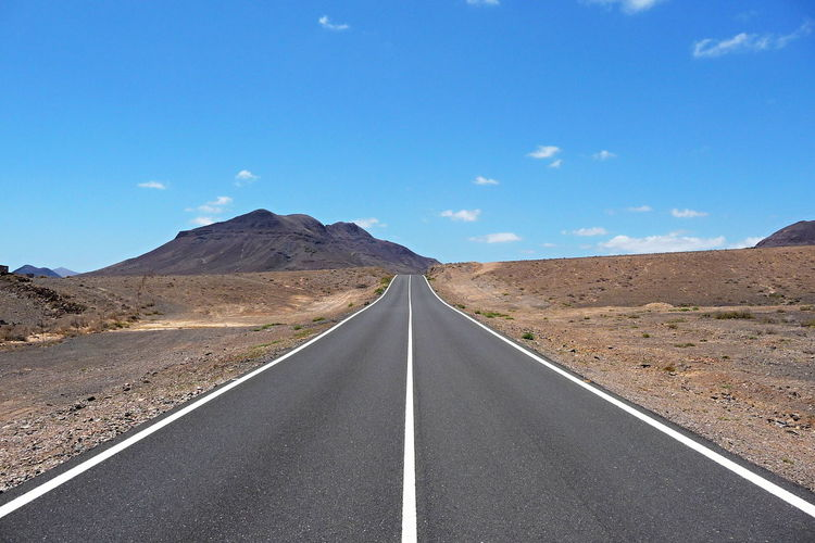 Arid Climate Asphalt Beauty In Nature Blue Clear Sky Development Diminishing Perspective Dividing Line Landscape Mountain Nature No People Non-urban Scene Outdoors Remote Road Scenics The Way Forward Transportation Ways Lost In The Landscape