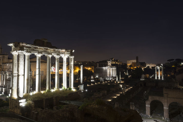 Ancient ruins at forum romanum in Rome, Italy Rome Architecture Ancient Travel Destinations City Forum Romanum Ruins Temple Monument Illuminated Night Palatino Real People Colosseum Colosseo Collonade Column Pillar Old-fashioned Roman Archaeology Old Ruin History Travel Italia