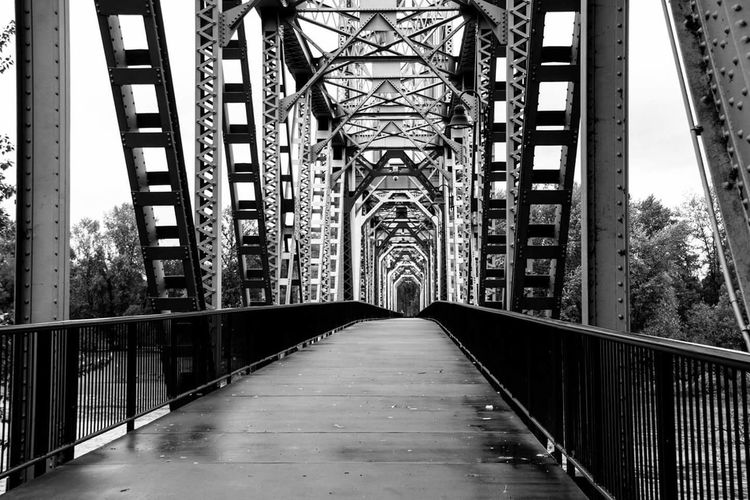 Monochrome Photography Architecture Built Structure Bridge Bkackandwhite Travel Travelphotography Urban Architecture Photography City Day Elevated Walkway No People The Way Forward Perspective Road Iron - Metal CannonEOSRebelT6i View