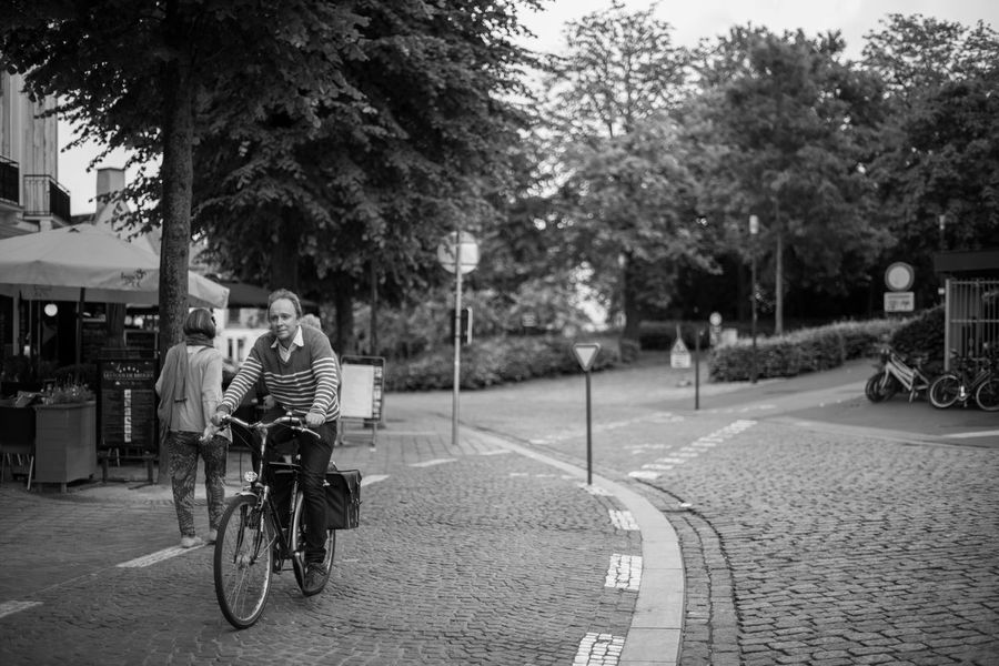 Bicycle Bicycle Track Bike Black & White Black And White Black&white Blackandwhite Blackandwhite Photography Bruges Brugge Brugge, Belgium City Cycling Cyclist Lifestyles Road Street Street Photography Streetphotography Trees Showcase June Fine Art Photography