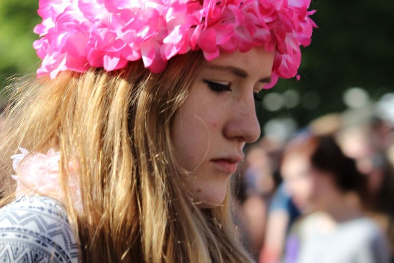 Artificial Flowers Close-up Day Focus On Foreground Headshot One Person Outdoors Pensive Mood Pink Flower Garland Side View Young Adult