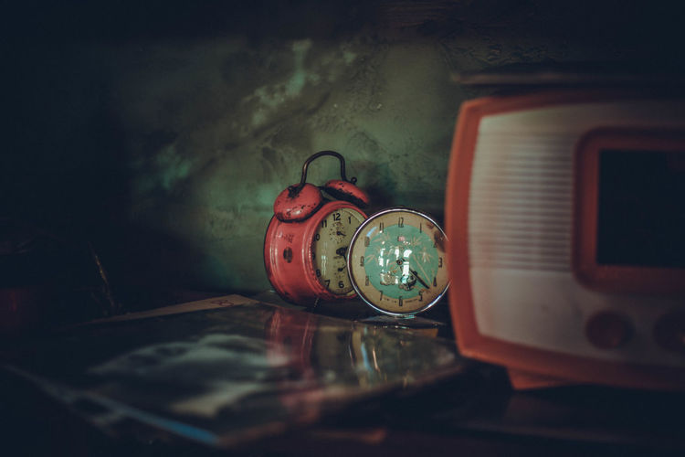 Close-up of alarm clocks on table