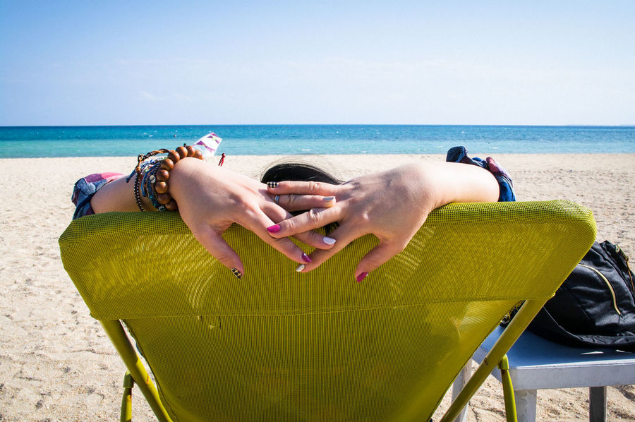 on the beach Sea Beach Water Real People Sky Relaxation Day Sand Okinawa Beauty In Nature Be Brave Leisure Activity Horizon Over Water My Best Travel Photo Land Horizon Lifestyles One Person Sunlight Nature Adult Chair Outdoors