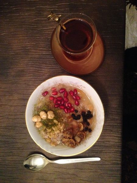 A glass of Turkish tea served with a bowl full with ashure. Spoon Turkish Food Ashure Aşure Food Food And Drink Freshness Healthy Eating No People Serving Size Table Tea Time Turkish çay First Eyeem Photo