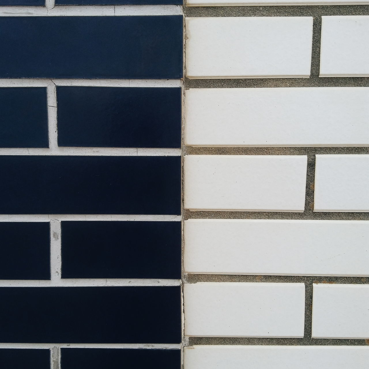 FULL FRAME SHOT OF TILED WALL WITH SHADOW