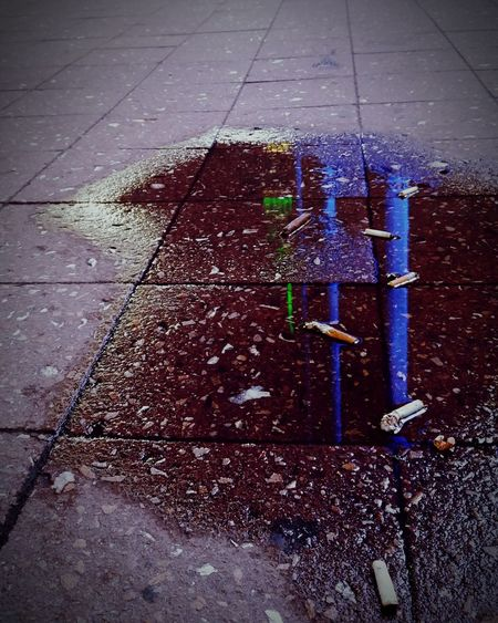 Showing Imperfection Cigarettes Kill Puddle Reflections NYC Street Photography