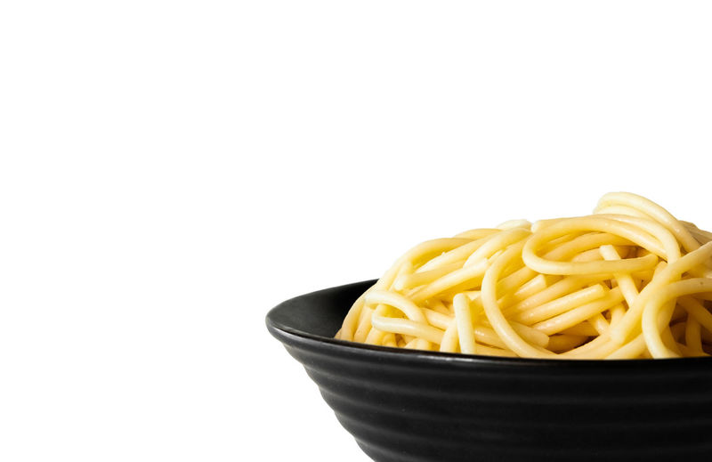 Close-up of noodles in bowl against white background