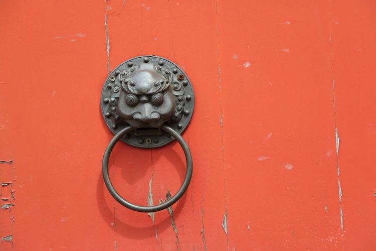 Knocker on orange door