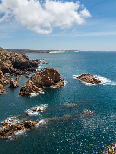 Cabo da Roca - Beautiful coastline of Portugal with Atlantic ocean and beach Water Sea Sky Beauty In Nature Scenics - Nature Rock Tranquil Scene Tranquility Cloud - Sky Horizon Horizon Over Water Land Rock - Object No People Nature Beach Day Solid Rock Formation Outdoors Rocky Coastline