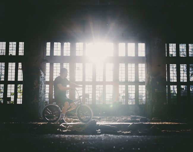 EyeEm Selects EyeEm Best Shots EyeEm Gallery EyeEmBestPics Bmx  Sunlight Architecture Window Built Structure Transportation Day Real People One Person Building Wheelchair Lifestyles Mode Of Transportation Full Length Lens Flare Men Indoors