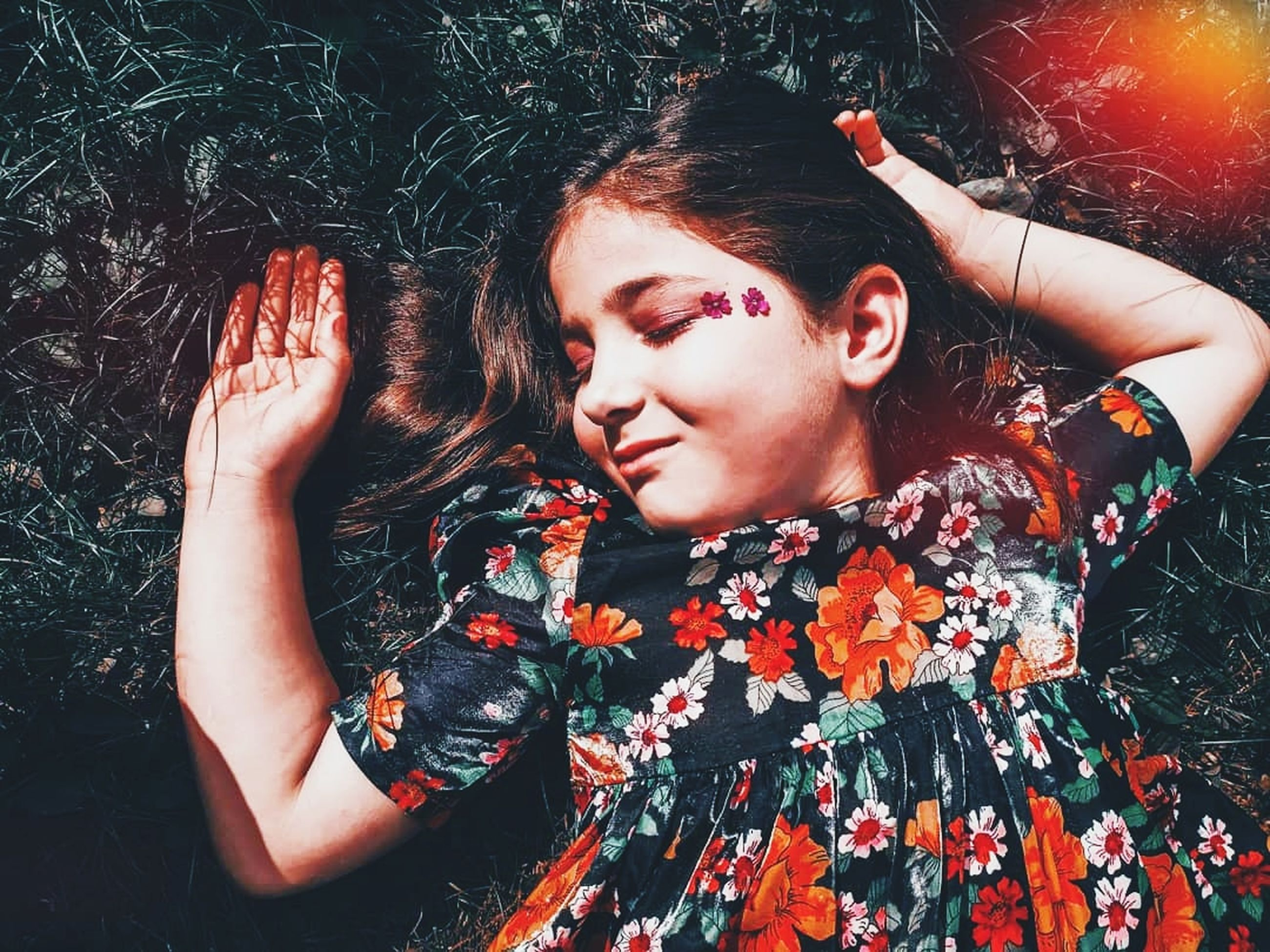 one person, red, young adult, women, adult, portrait, lying down, fashion, eyes closed, nature, lifestyles, front view, high angle view, hairstyle, person, waist up, leisure activity, night, photo shoot, lying on back, relaxation, female, casual clothing, outdoors, clothing