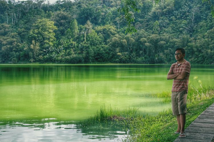 Water Tree Nature Standing One Person Rear View Lifestyles Lake Real People Outdoors Green Color Beauty In Nature Day Manado - North Sulawesi, Indonesia. Linow