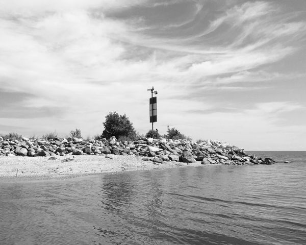 EyeEm Selects Lighthouse Sea Guidance Water Sky Building Exterior Tower Direction Safety Architecture Built Structure Protection Cloud - Sky Day Nature Beach Tranquility Outdoors No People Horizon Over Water