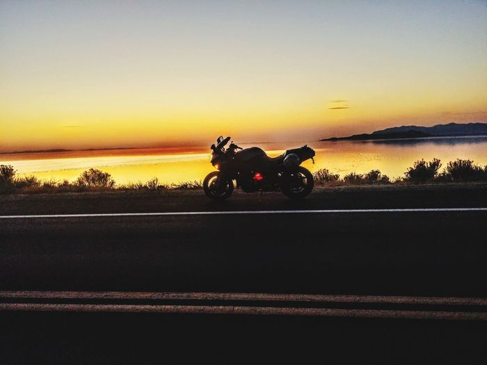 Went for a ride out in antalope island, got a great shot of my bike in the sunset Sunset Transportation Mode Of Transport Travel Landscape Rural Scene Land Vehicle Outdoors Sky Beauty In Nature Nature Day Dusk Evening Backgoundsun Nature Motorcycle Water Lake Antelopeisland Motorsport Ninja Zx6