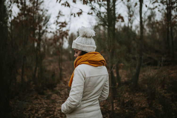 Into The Woods Into The Wild Nature On Your Doorstep Forest Winter Yellow White Tree Clothing Land One Person Lifestyles Real People Waist Up Warm Clothing Standing Leisure Activity White Color Outdoors WoodLand Scarf Hood - Clothing Rear View Nature Knit Hat Plant 2018 In One Photograph