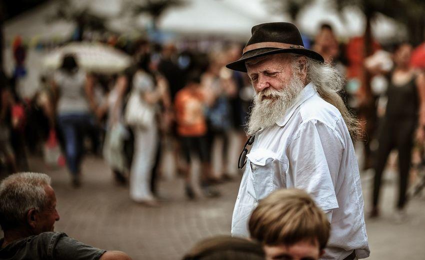 Senior man walking on footpath in city