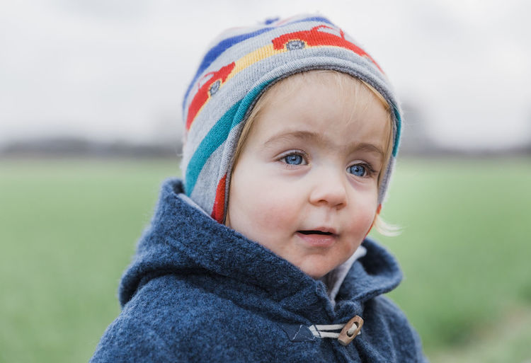 Portrait of toddler girl with warm clothing – Kempen, Germany Head And Shoulders Toddler  Toddlerlife Duffle Coat Wool Girl Girls Females Blue Eyes Germany Caucasian Looking Away Field Nature Grass Toggle Button Contemplation Content Day Dreaming Dreaming Face Faces Of EyeEm Facial Expression Talking Communication Child Childhood Portrait Clothing Headshot Focus On Foreground One Person Innocence Warm Clothing Close-up Winter Knit Hat Cute Hat Looking Baby Looking At Camera Smiling Young Hood - Clothing Outdoors Scarf