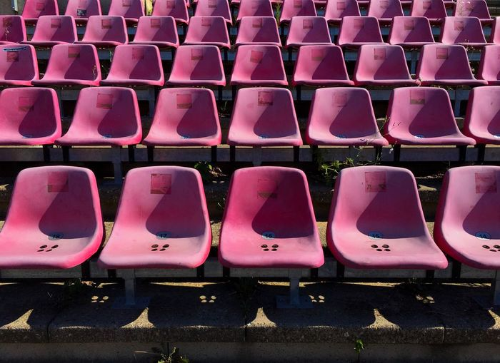 Empty seats of bleachers in stadium