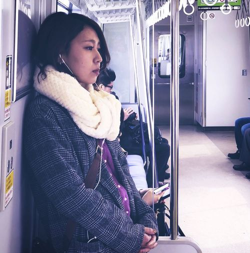 Young woman looking through train window