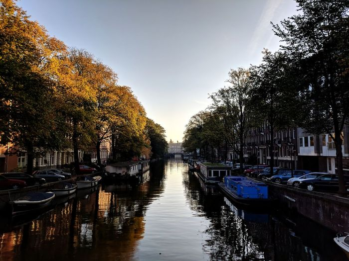 Amsterdam being Amsterdam - really lucky with this warm October Friday. KotlinConf Canal Tree Water City Reflection Sky Bridge - Man Made Structure Riverbank