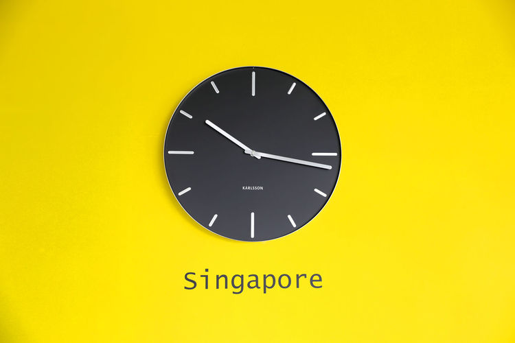 Time in Singapore Business In Asia Singapore Singapore Business Singapore Time Time In Singapore Time On The Wall Yellow Wall And Clock Clock On The Wall Singapore Business Centre Time Is Up Watch