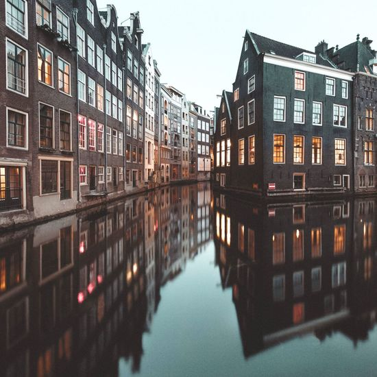 Favorite spot in AMS Amsterdam Reflection Canal Water Building Exterior Architecture Built Structure Reflection Waterfront Outdoors Day Residential Building Window No People Clear Sky City Sky The Architect - 2017 EyeEm Awards EyeEmNewHere Streetphotography Long Exposure Holland